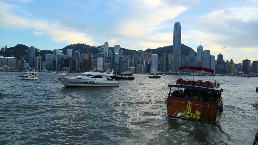Kowloon, HongKong-18 June, 2016: View Of Cityscape with boats and ferries in Kowloon Bay, skyline Hong Kong background -Dan | Shutterstock HD Video #18516497