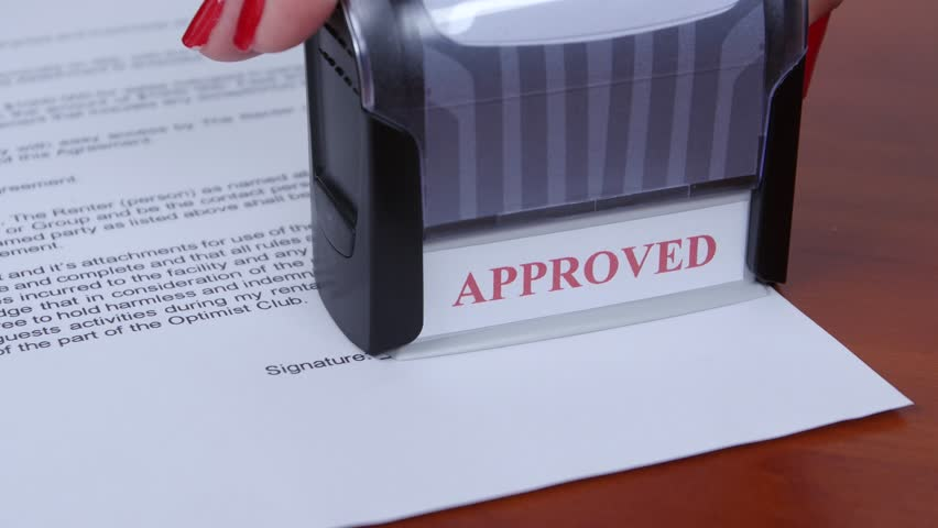 Man Buying A Car And Signing Car Sale Contract On The Car Buyers