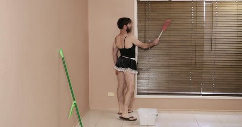 man in French maid drag cleaning with attitude
