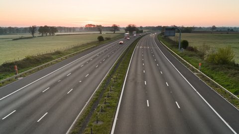 Wiltshire, UK - April 2016: Sunrise over M4 motorway, Wiltshire, UK. The M4 is a motorway which runs between London and South Wales in the United Kingdom. It is 192 miles (309km) long.