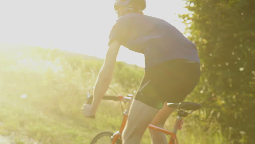 Young man Cyclist on road bike in sunset. Cycling. Slow motion #18557657