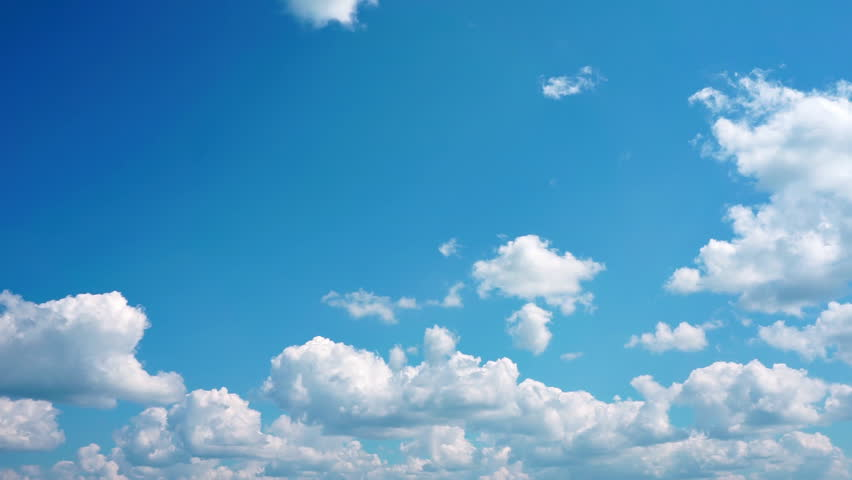Timelapse of white clouds running over blue sky #18576827