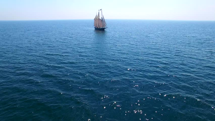 Tall ship at sea, majestic vessel sailing in open waters.
