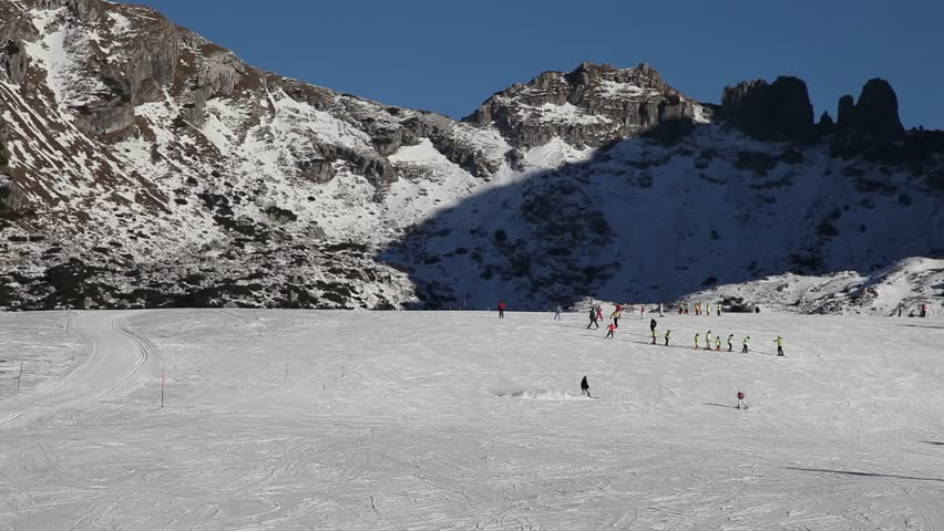 People skiing on a wide track