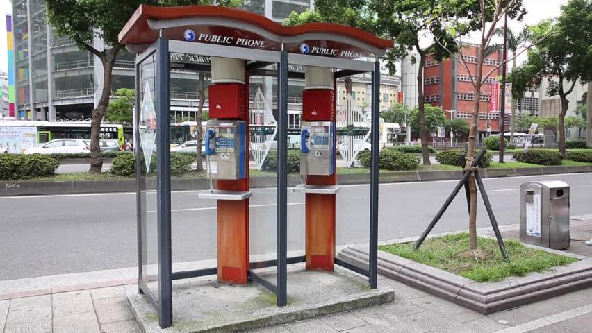 TAIPEI, TAIWAN - MAY 10, 2016: Public telephone booth on sidedwalk Ximendind Taipei, Taiwan. | Shutterstock HD Video #18636527