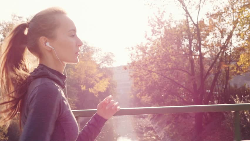 Runner Woman Running in the Sunny City Park Exercising Outdoors. Steadicam STABILIZED shot, SLOW MOTION 120 fps. Sportswoman Listening to Music during Morning Training. Healthy Lifestyle. Lens Flare. | Shutterstock HD Video #18640727
