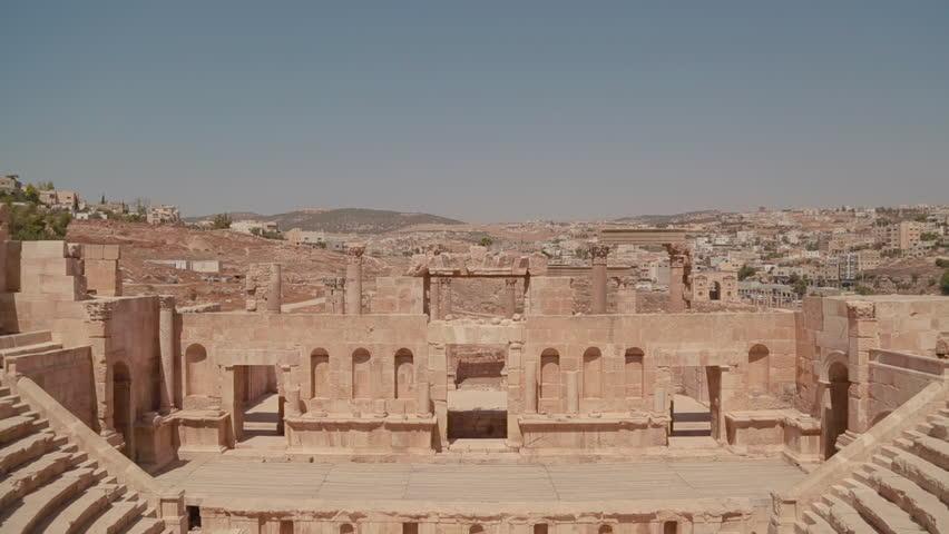 An establishing shot of Amman, Jordan with Roman ruins foreground. (Amman, Jordan 2010s)