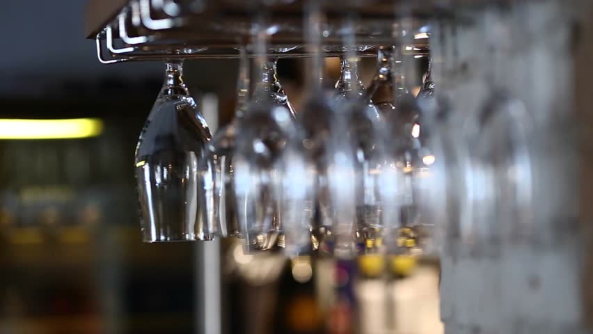 Many, a large number of wine glasses hanging upside down in cafe storane #18749627