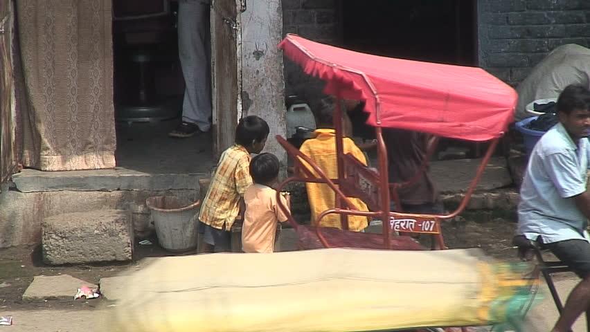 NEW DELHI, INDIA - AUGUST 31, 2007:  Kids eat on the street