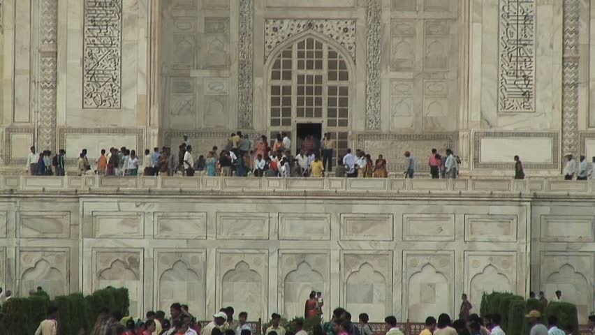 AGRA, INDIA - AUGUST 16, 2006: A crowd gathers at the Taj Mahal  in Agra, India