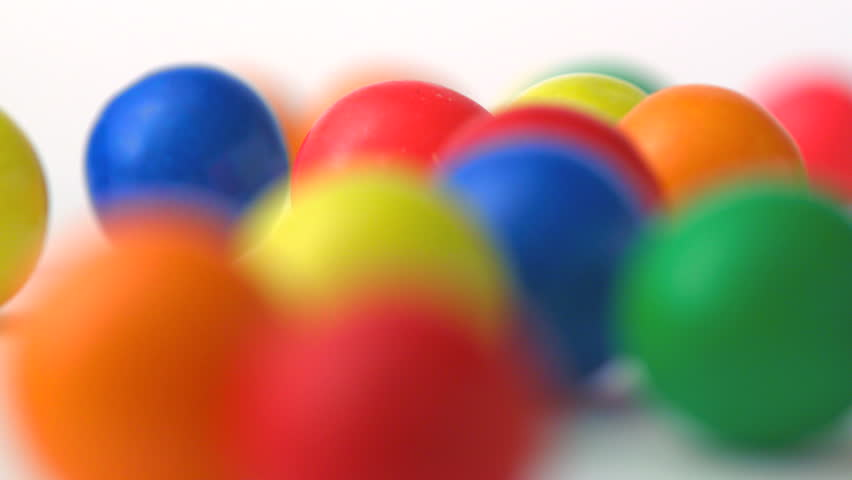 Extreme close-up gumballs rolling, Slow Motion