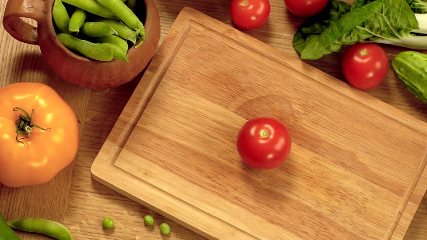 table top background hd. light wooden cutting board in a kitchen table. small red tomatoes sliced half table top background hd t