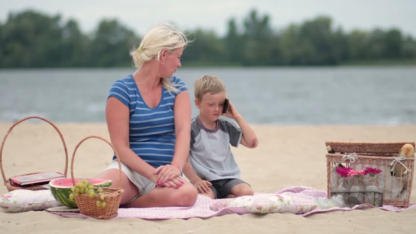 Mother and son talking on the phone | Shutterstock HD Video #18849497