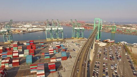 4K Aerial Hyperlapse view moving backward from shipyard and freeway. Long Beach, Los Angeles, CA, USA