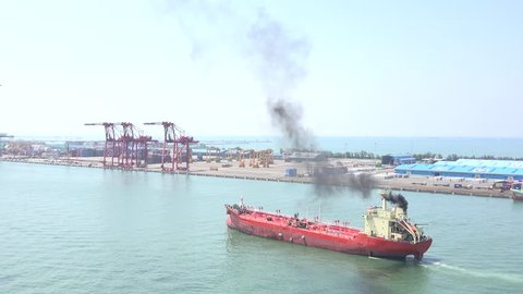 A oil tanker ship designed for the bulk transport of oil. The port of Kaohsiung, the largest harbor in Taiwan. 4K