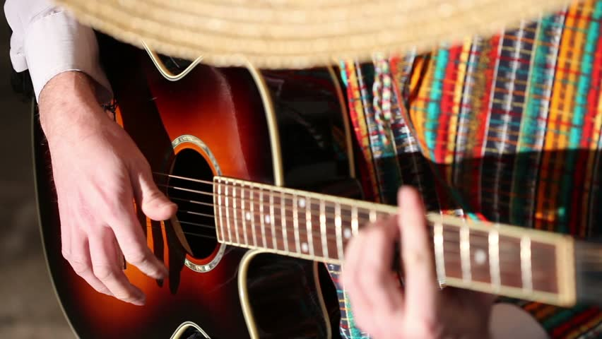 a man in a Mexican poncho and sambrero professional playing guitar, smale hands playing on the strings of a guitar, hands guitarist guitar fingers on the fretboard, guitar, string, close-up, video, HD
