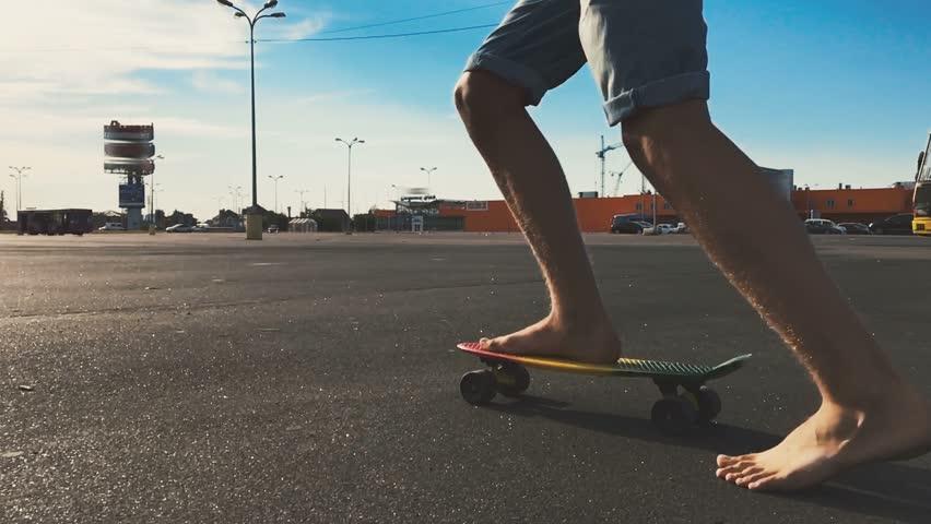 Barefoot boy riding a skateboard (panybord), slow motion. #18948257