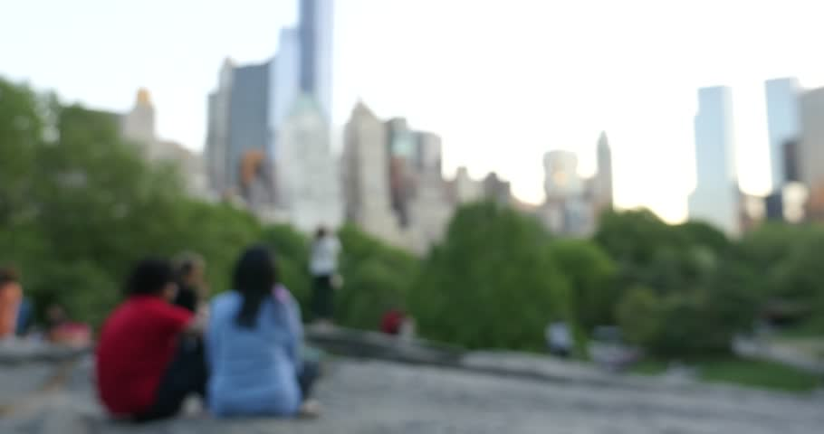 Defocused scene of people relaxing outdoors at dusk in Central Park. The park is the most visited urban park in the United States with 35 million visitors annually. | Shutterstock HD Video #18986707