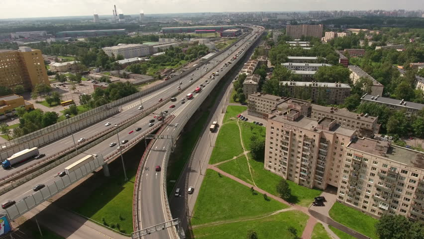 City ring highway leads to south-west in the Rybatskoye municipality, Nevsky sleeping district. Aerial view. St. Petersburg, Russia | Shutterstock HD Video #18988717