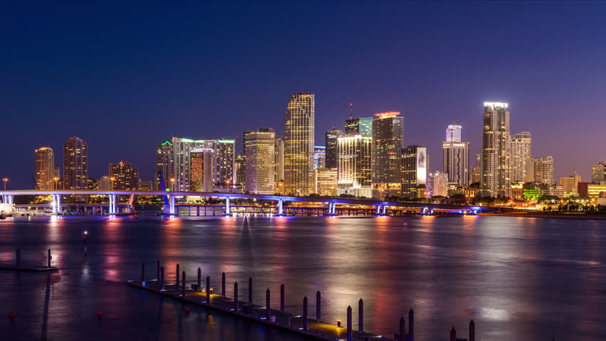 Miami, Florida, USA skyline time lapse over the bay.