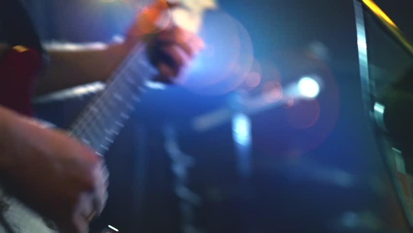 Man singing and playing guitar, Rock band Rehearsal. Guitar closeup. Full HD video footage 1920x1080p Man lead guitarist playing electrical guitar | Shutterstock HD Video #18992437