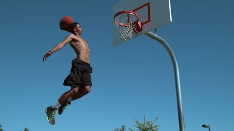 Super slow motion shot of basketball basketball slam dunk, shot on Phantom Flex 4K