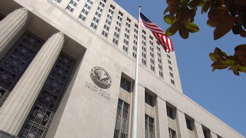 Downtown Los Angeles United States Court House, low angle shot, US Flag flying in front of the building