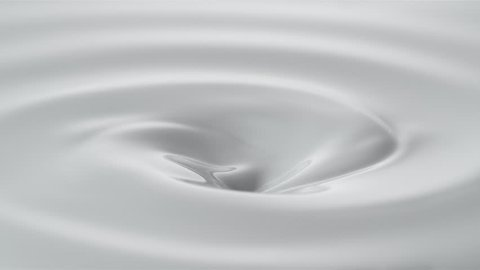 Pouring milk into swirl of milky liquid. Shot with high speed camera, phantom flex 4K. Slow Motion.