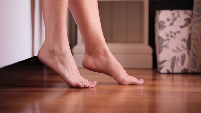 Side view of barefoot legs of woman walking on the floor behind video of woman getting out of the bed feet touching floor in the morning hd voltagebd Image collections
