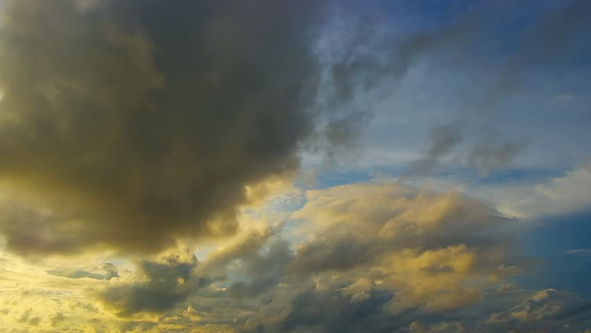 A colorful time lapse video of cumulus clouds moving and changing shape, set against the morning sky. It has a slow, soothing pace. Shot in the topics, right after sunrise.  | Shutterstock HD Video #19066777