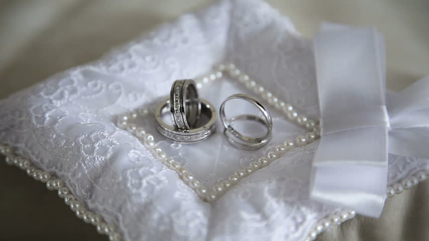 Two Wedding Ring On A Beautiful Cushion Wedding Concept Stock