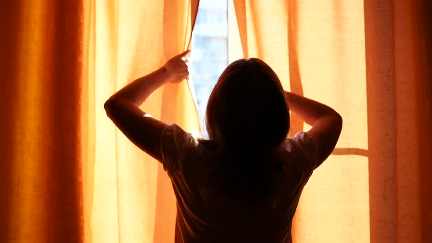 the girl opens the curtains on a Sunny day #19078657