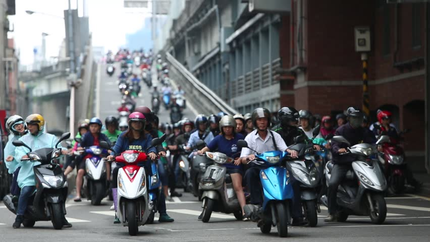 Taipei, Taiwan-24 May, 2016: Traffic Motorbikes Driving On The Road for