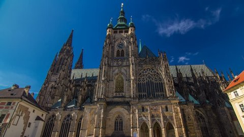 St. Vitus Cathedral timelapse hyperlapse in Prague surrounded by tourists. Located within Prague Castle and containing the tombs of many Bohemian kings and Holy Roman Emperors.