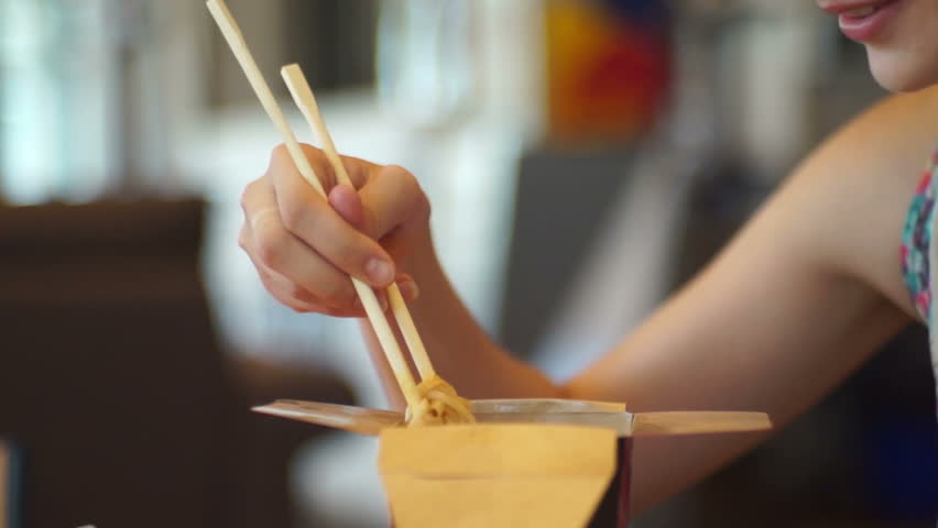Girl eating Chinese noodles