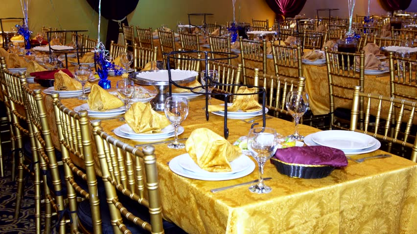 Restaurant Background With People luxury banquet table setting at restaurant. blurred background
