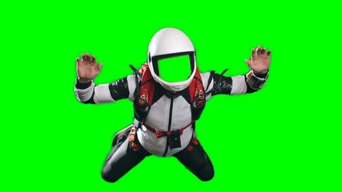 No face chroma key template for video editing, slow-motion shot of young man parachutist in full gear, white helmet, jumpsuit and harness, performing free fall against green screen background