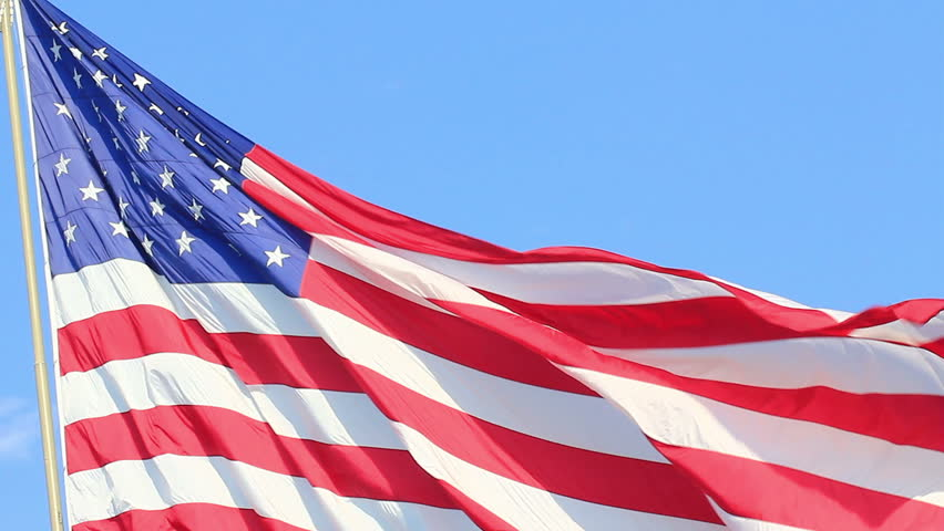 Closeup of jumbo American flag against a blue sky - HD - 1920x1080