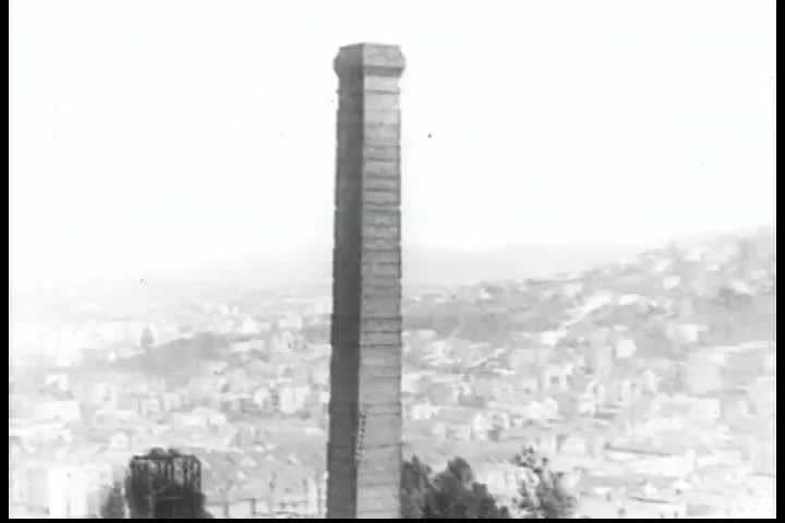 A high tower in San Francisco, California in the 1920s, is imploded, collapses, and smashes to the ground, creating a huge pile of rubble. (1920s)