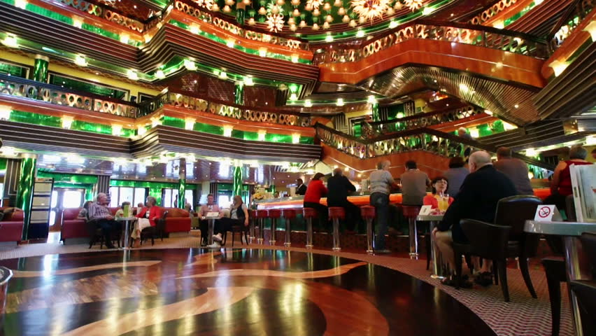 MEDITERRANEAN SEA - MARCH 16: Unidentified passengers of the Costa Concordia cruise ship relaxing at the elegant lobby bar, 16 March 2011. The Costa Concordia cruise ship ran aground and sank on January 16, 2012.