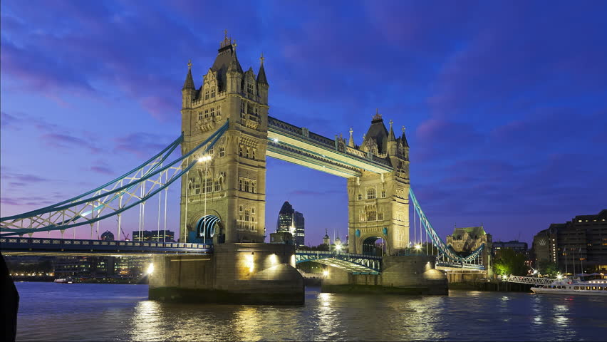 Tower Bridge in London opening for passing underneath boat, London, United Kingdom