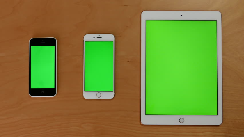 Coquitlam, BC, Canada - August 07, 2016 : Top shot of hand touch phones and ipad on green screen #19286467