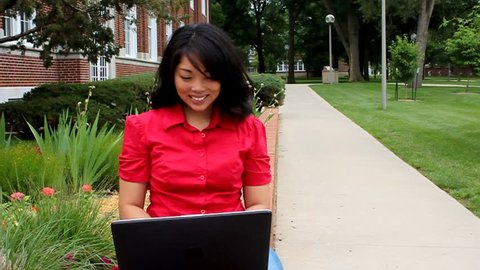 A beautiful college student using a laptop