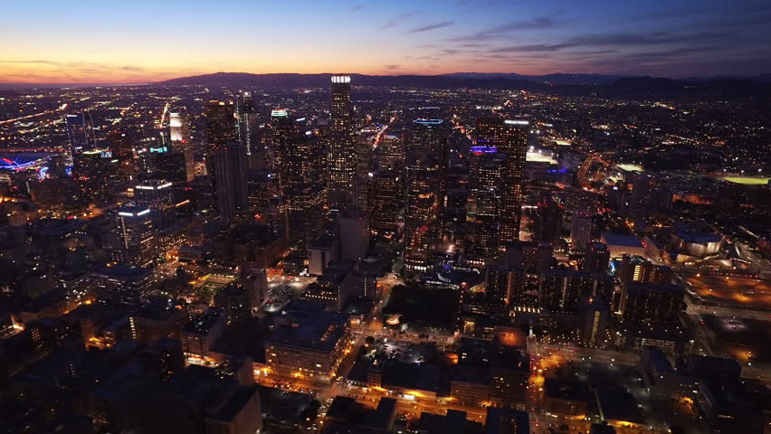 Aerial view of the Financial District in Downtown Los Angeles, California. Beautiful view of  Los Angeles skyline at sunset. Famous skyscrapers and freeway full of cars.