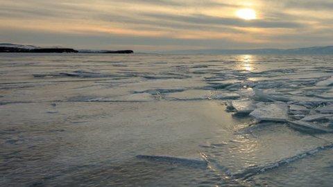 Sunset in the icy Lake Baikal, Irkutsk region, Russia. Full HD