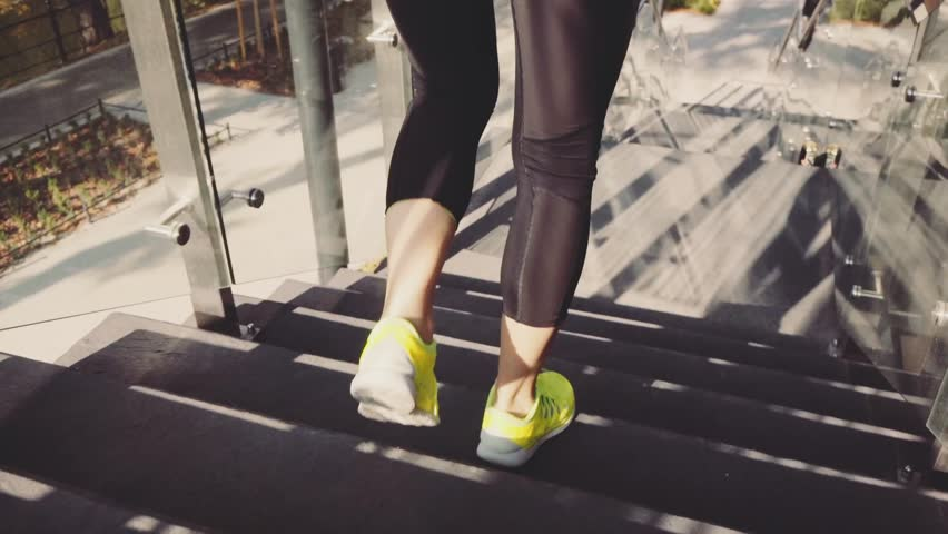 Runner Woman Jogging down Stairs, Lens Flare. SLOW MOTION 120 fps Steadicam STABILIZED shot. Athletic Sportswoman Running down the Modern Sunny Glass Stairs. Healthy Lifestyle and Wellness.   | Shutterstock HD Video #19344067