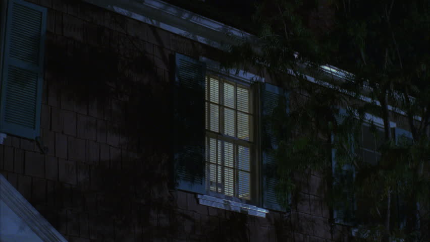 Night Pan left from one window light another light , both w blue shutters 2nd floor Raked left 2 story cape cod house | Shutterstock HD Video #19352047