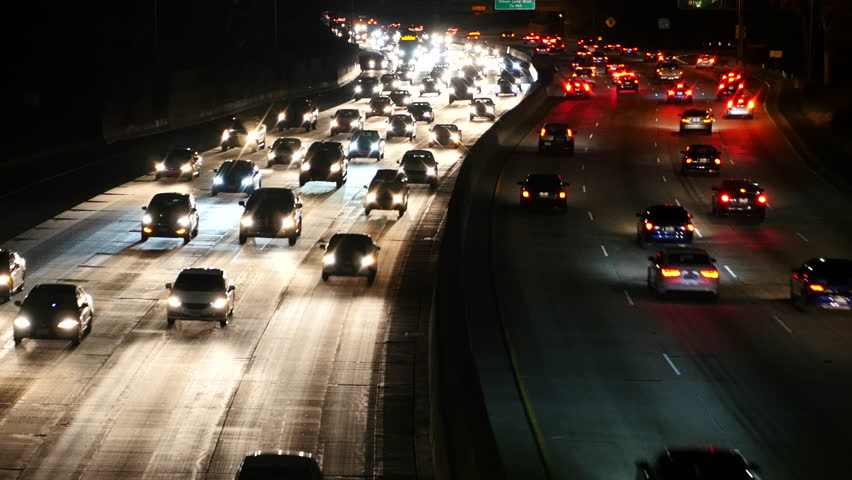 Zoom Out - Traffic on the 101 Freeway in Los Angeles - Night | Shutterstock HD Video #19359997