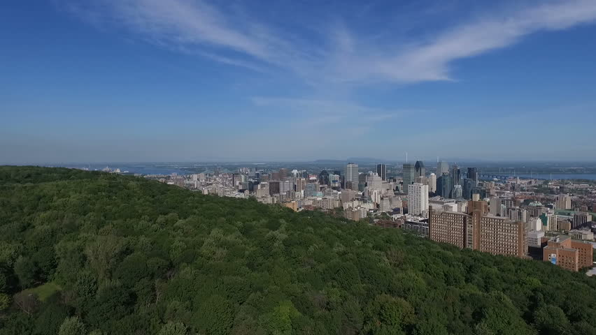 Aerial Footage of Montreal City Downtown in Quebec, Canada during Summer 2016 - Beautiful Nature/Civilization Contrast