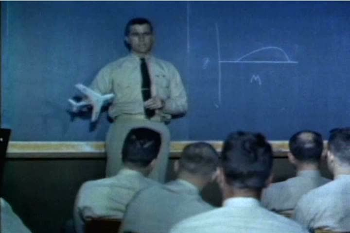 After a morning class on engineering, students at the US Naval Test Pilot School check a giant schedule which tells them who is running a test pilot when, in 1959. (1950s)